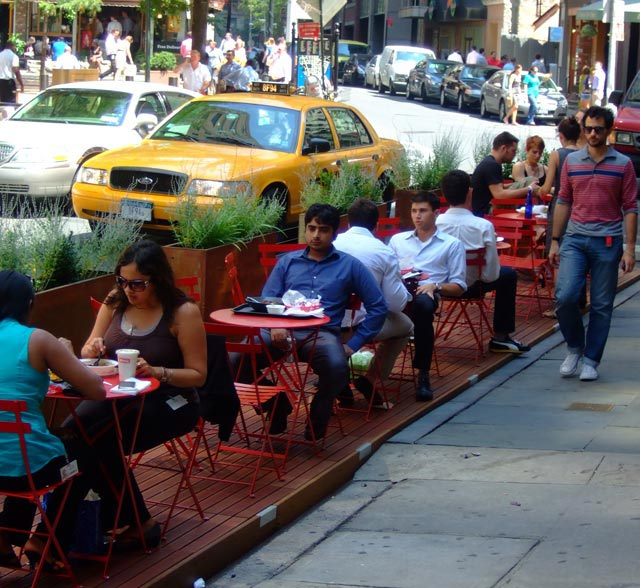 In case you were missing a sidewalk cafe on your block, never fear, DOT will install one in your roadbed !