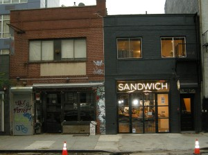 The former Hung-Ry restaurant space on the left and the current Mile-End Sandwich Shop on the right, both housed in the 55 Bond St. lot